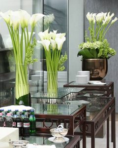 White callas decorate the buffet table in military order