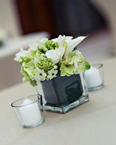 Classical white cocktail decoration in glass vase, with tealights