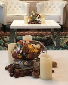 Cocktail decoration with berries, chestnuts and candles