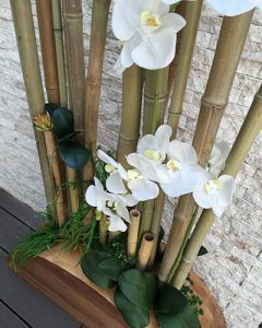 Interior decoration with bamboo and artificial orchids