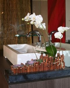 Bamboo orchid decoration as part of bathroom deco