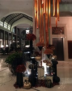 Halloween lobby decoration with black pumpkins