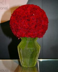 Red Vermont roses in vase shaped decoration