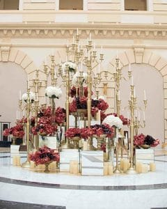 Luxury lobby decoration with gold candelabras, hydrangeas and orchids.