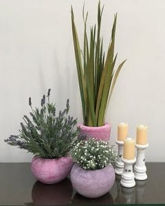 Interior decoration from artificial plants in pink and lilac