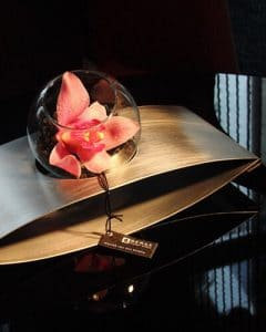 Orchids in design metal vase