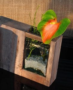 Squared wooden vase with flamingo flower