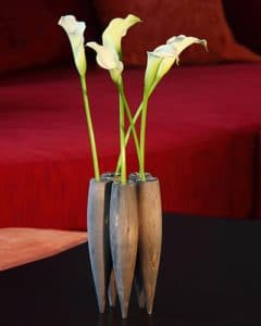 Elegant wood vase with flowers as a gift