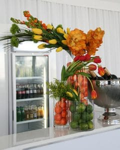 Orange coloured buffet decoration with fruits