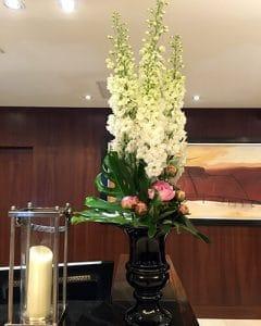 Reception desk decoration with white delphiniums