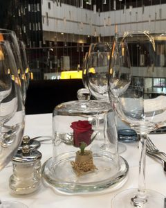 Restaurant table decoration under glass dome