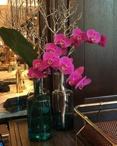 Restaurant welcome counter with orchids