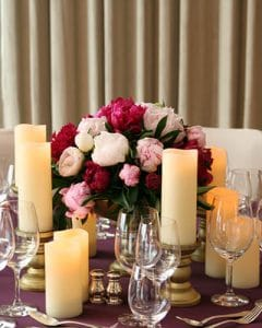 Peony table decoration with wax candles