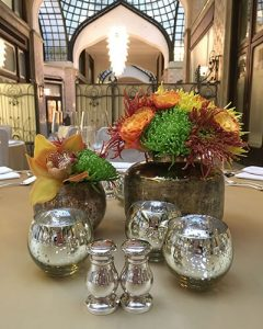 Table decoration group in golden vases with candleholders