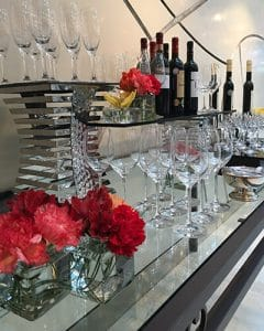 Wine buffet decoration with little mixed bouquets