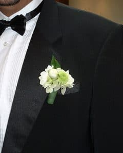Little white-green groom boutonniere