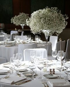 Tall wedding table decoration of baby's breath