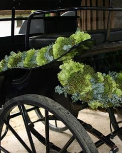 Wedding carriage decoration with modern garland