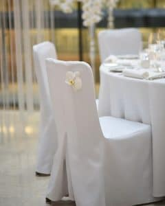 Wedding chair decoration with orchid heads